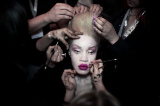 JOHANNESBURG, SOUTH AFRICA OCTOBER 25: A fashion model has her makeup and hair done backstage before a show at Mercedes Benz Africa fashion week on October 25, 2012 held in Johannesburg, South Africa. African designers from around the continent showed their best fall/winter collections. (Photo by: Per-Anders Pettersson)